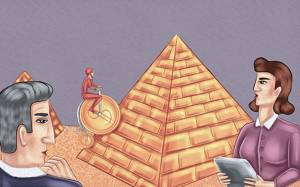 Two people watching at man who rides a bicycle onto a pyramid of gold bars.