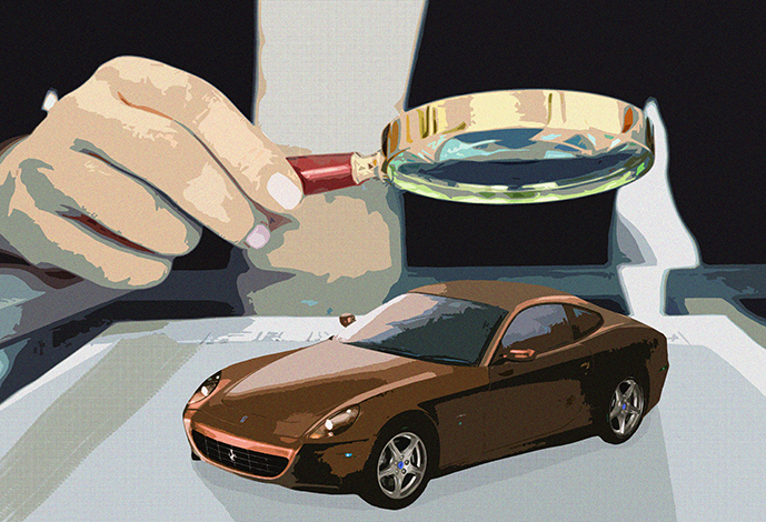 A man holding a magnifying glass and studying the car he is going to finance.